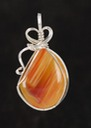 orange queensland agate wire wrapped sculpted sterling silver cab cabochon pendant jewelry